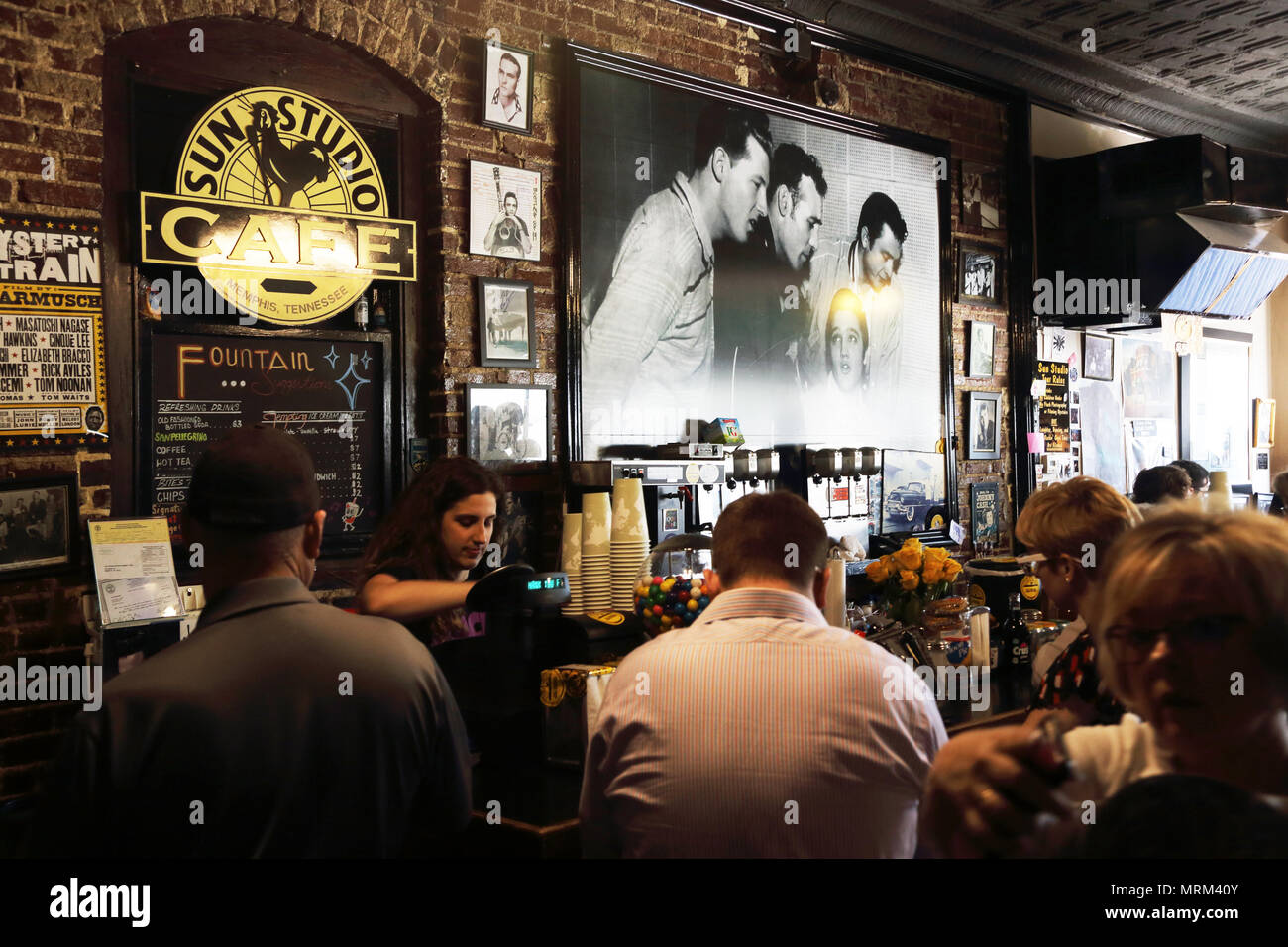 Visitors inside of the gift shop and cafe of legendary Sun Studio in Memphis. Tennessee. USA - Stock Image