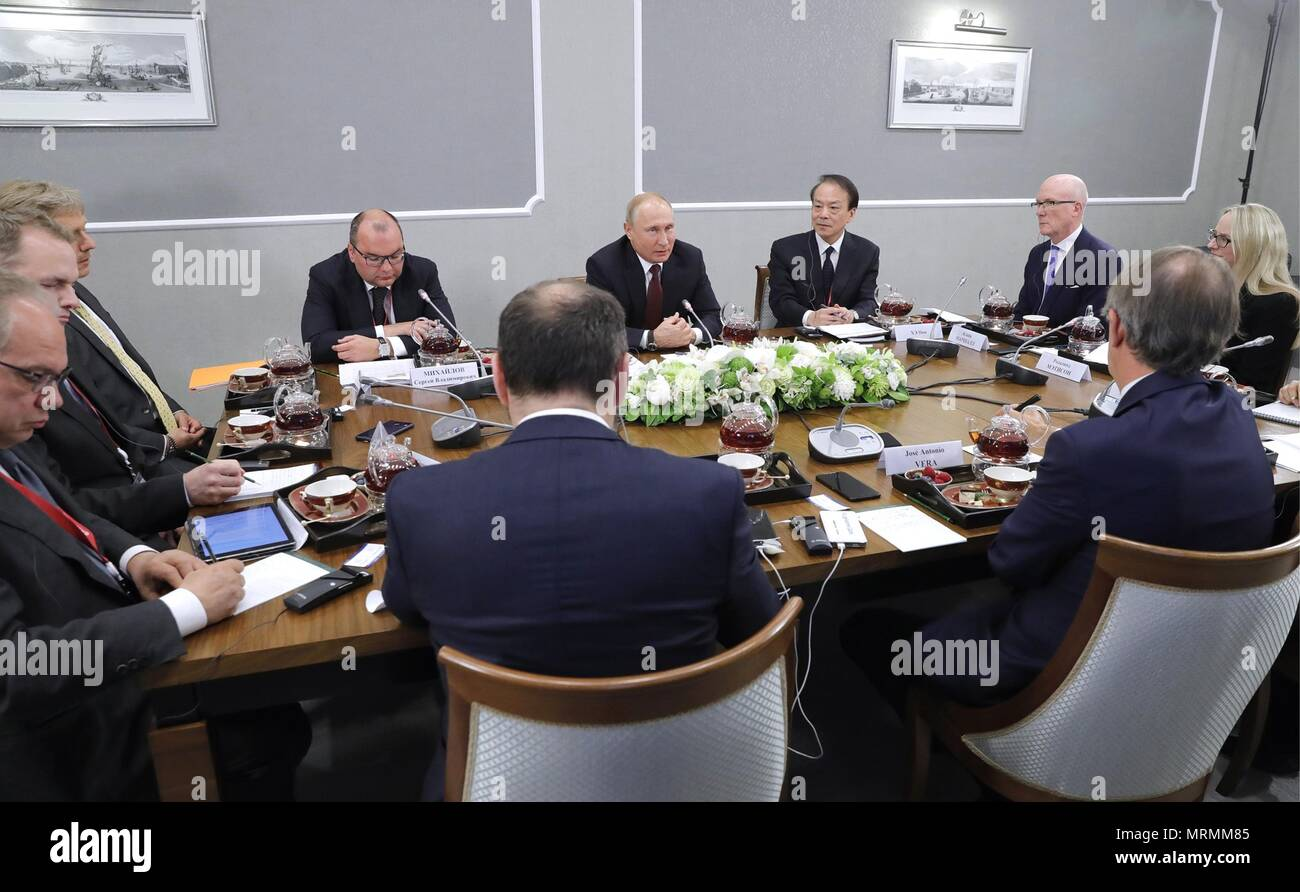 Russian President Vladimir Putin, center, during a meeting with international news agency editors on the sidelines of the 22nd St Petersburg International Economic Forum May 25, 2018 in St. Petersburg, Russia.    (Russian Presidency via Planetpix) - Stock Image