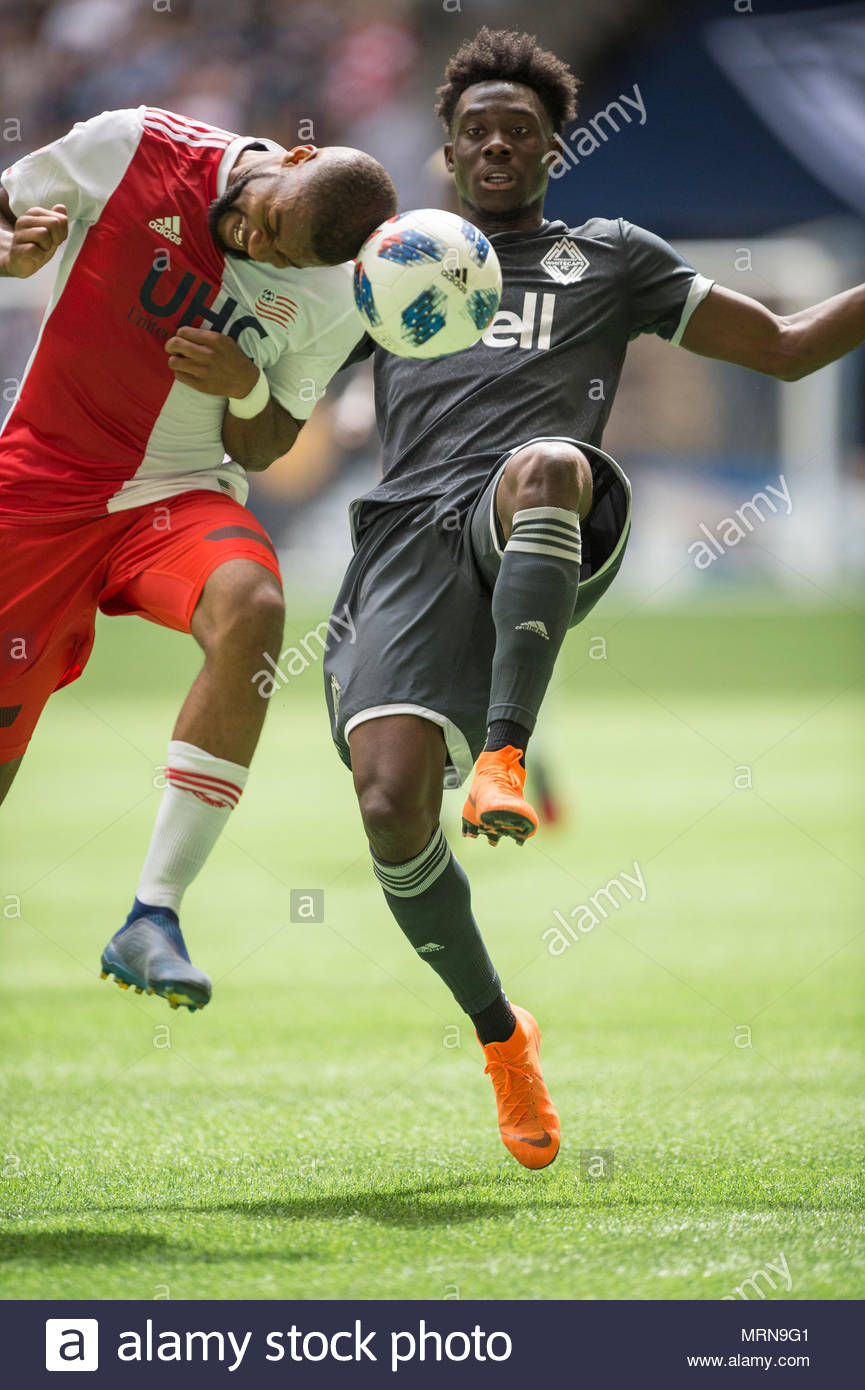 Vancouver, Canada. 26 May 2018. Alphonso Davies (67) of Vancouver Whitecaps, and Andrew Farrell (2) of New England Revolution, vying for the ball. Game ends with a 3-3 tie. Vancouver Whitecaps vs New England Revolution BC Place.  © Gerry Rousseau/Alamy Live News - Stock Image