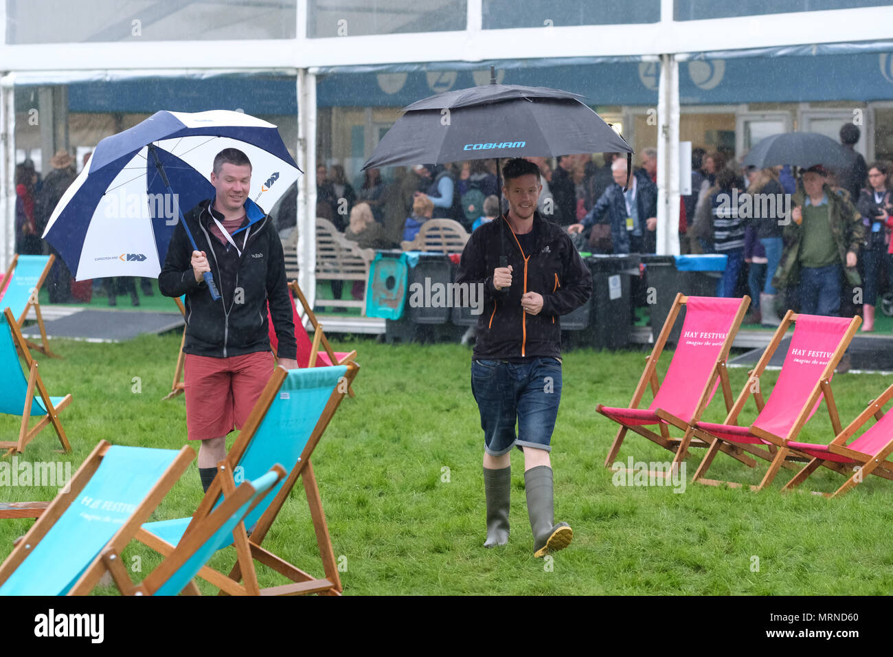 Hay Festival, Hay on Wye, UK - May 2018 - Brolly weather at the Hay Festival in Powys, Wales as visitors dodge heavy showers between events by leading authors, actors and thinkers - Photo Steven May / Alamy Live News - Stock Image