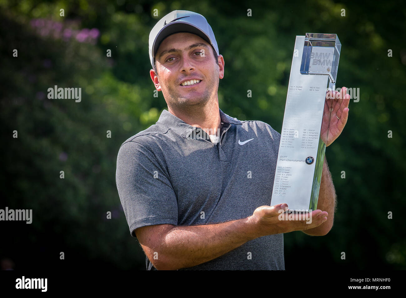 Surrey, UK. 27th May, 2018. To the Victor the spoils Francesco Molinari holds aloft the BMW PGA Championship Trophy after beating Rory Mcilroy into second place at Wentworth this afternoon. This is his 5th European Tour Victory and the first time he has won this event having finished second last year. Credit: David Betteridge/Alamy Live News - Stock Image