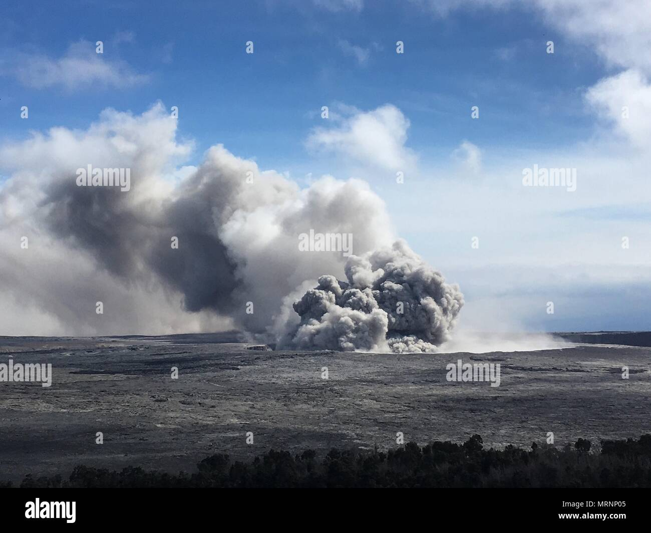 An ash plumes rises from the Halemaumau crater at the summit of the Kilauea volcano May 23, 2018 in Pahoa, Hawaii. Stock Photo