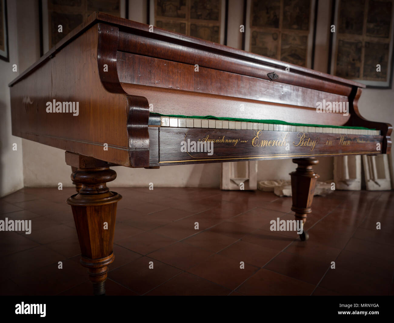 Antique Emerich Betsy piano constructed in 1854. These pianos were made with Burl Wood, each finished with hand craftsmanship inclusive of hand-carved - Stock Image