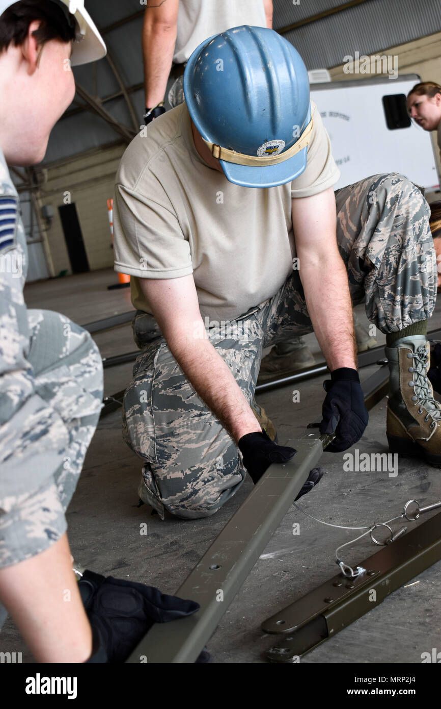 Tech Sgt Michael Smith, 134th Services Flight, helps construct
