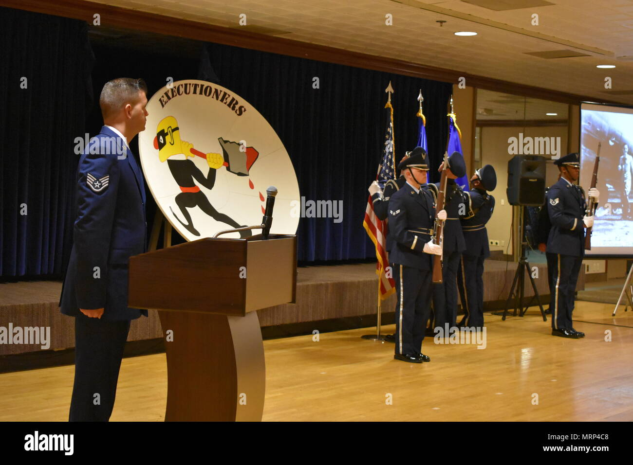 """25th Space Range Squadron collectively celebrate the squadron's 100th birthday during the 25 SRS Centennial Dinner Banquet at Peterson Air Force Base, Colorado, Wednesday, June 21, 2017. The 25 SRS extended invitations to any and all """"Executioners"""" to celebrate this momentous milestone. (U.S. Air Force photo/2nd Lt. Scarlett Rodriguez) Stock Photo"""