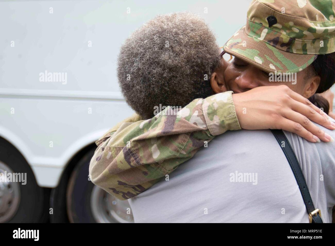 BIRMINGHAM, Al (June 24, 2017)— Spc. Amber Moore, power-generator equipment repairer with the 135th ESC, in a tearful embrace with her mother, Lisa Moore, before departing for Fort Hood, TX. For many of these Soldiers and their families it will be their first time going through a deployment. (U.S. Army photo by Cpl. Jaccob Hearn) - Stock Image