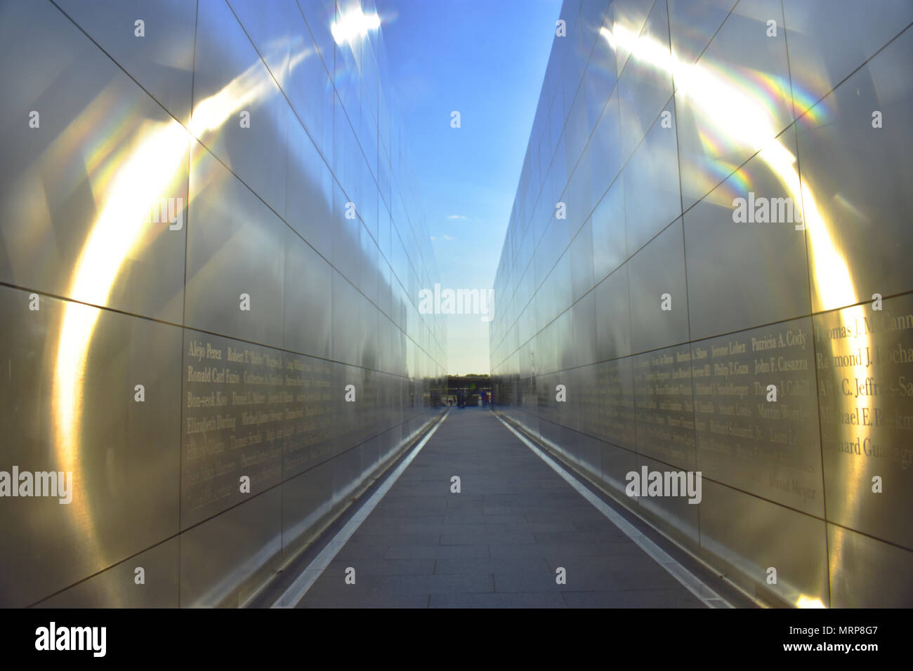 The setting sun reflects a ring of fire inside the Empty Sky memorial at Liberty State Park in Jersey City, NJ - Stock Image