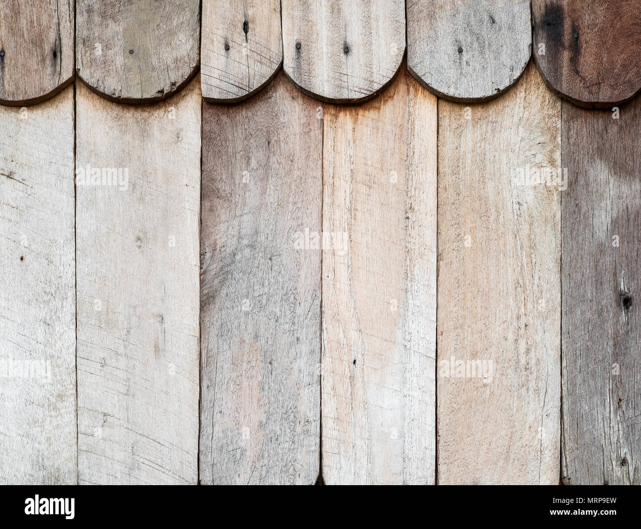 Close up of old vintage vertical outdoor wooden wall pattern from part of farmer house on countryside. - Stock Image