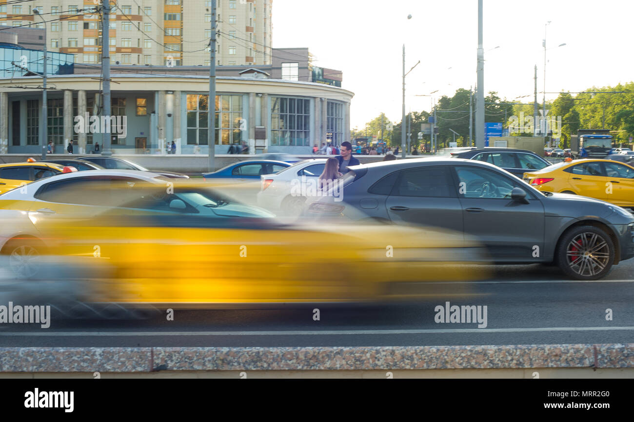 Traffic accident involving taxi and car on the road. - Stock Image