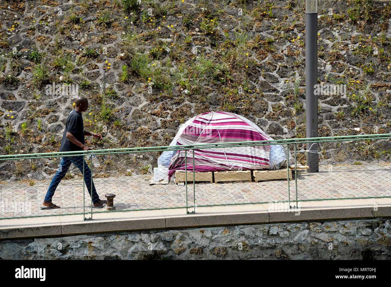 La Villette Migrant Camp in Paris, Canal d'Aubervilliers - France - Stock Image