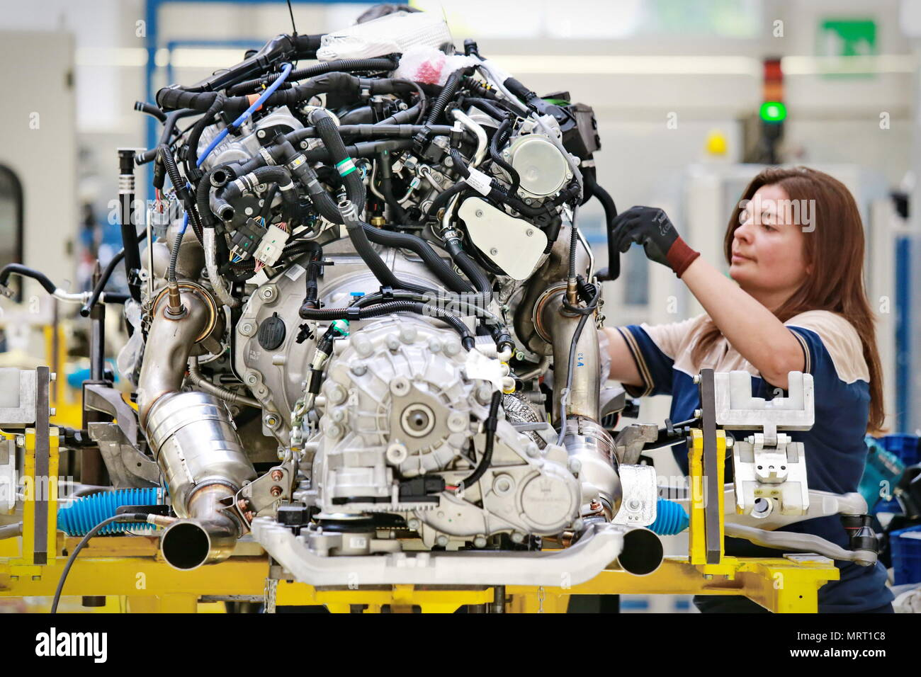 Grugliasco, Italy - June 30, 2014: car production line with unfinished cars in a row at Maserati factory. - Stock Image