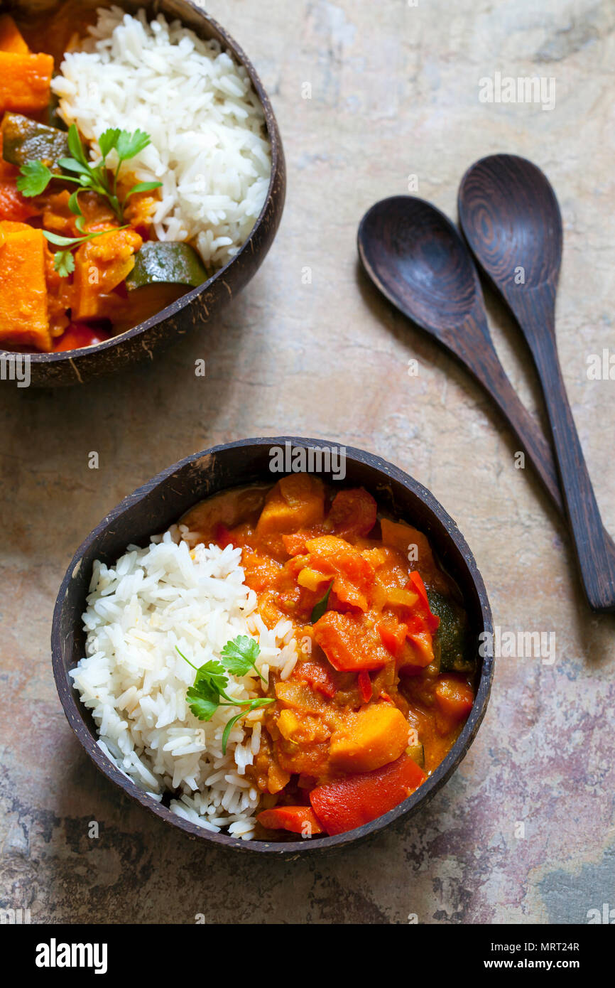 Sweet potato, courgette and red pepper vegan curry with rice and micro coriander - Stock Image