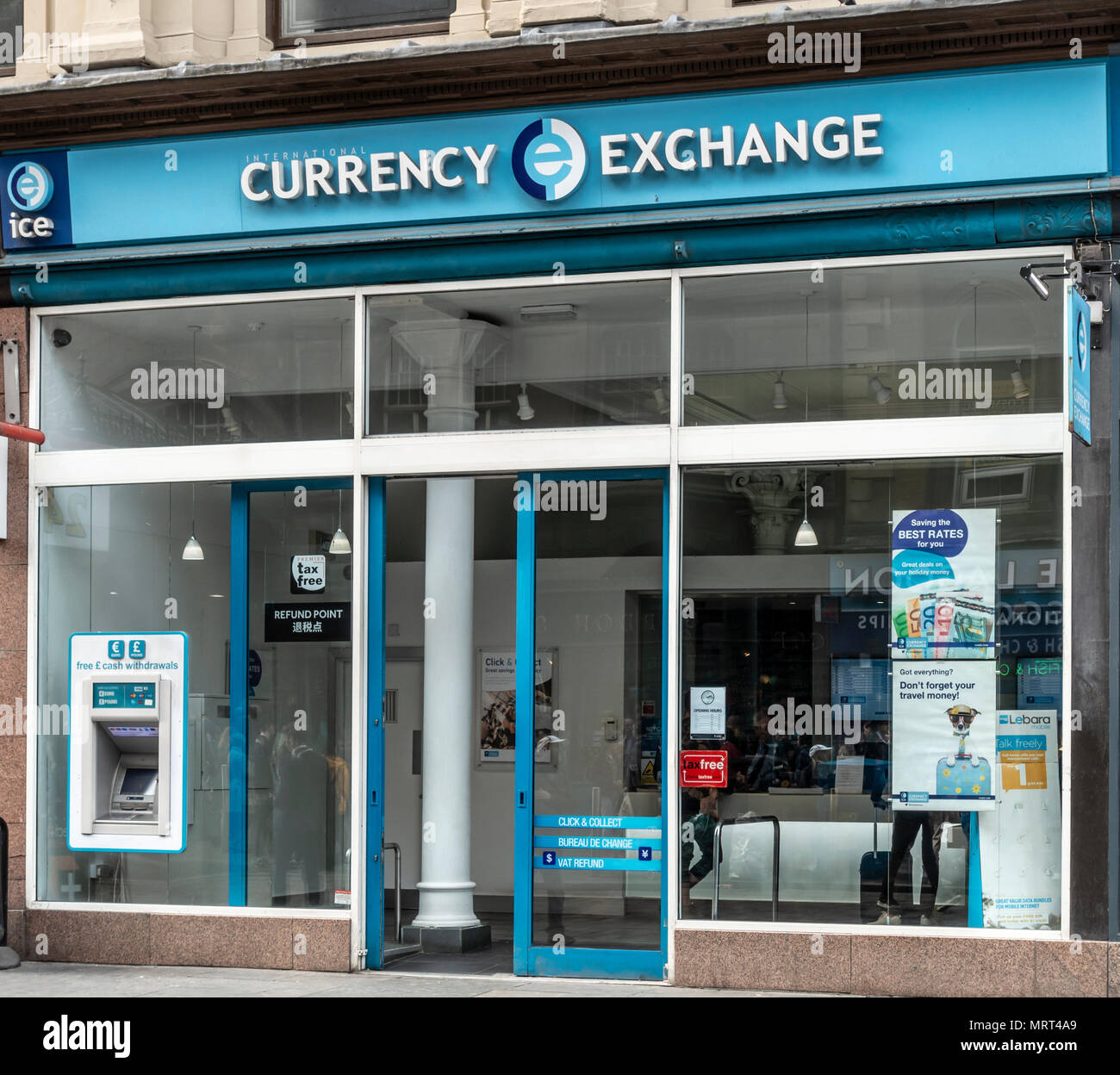 Frontage and entrance of the branch of International Currency exchange opposite Glasgow Central Station, Scotland, UK - Stock Image