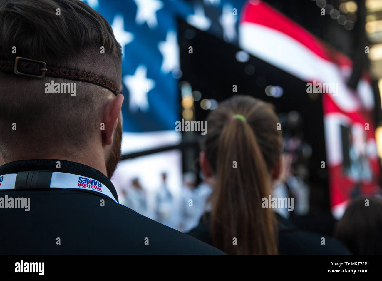 Team Army stands for the singing of the National Anthem during the opening ceremony for the 2017 Department of Defense Warrior Games at Chicago, Ill., July 1, 2017. The DOD Warrior Games are an annual event allowing wounded, ill and injured service members and veterans in Paralympic-style sports including archery, cycling, field, shooting, sitting volleyball, swimming, track and wheelchair basketball. (U.S. Army photo by Spc. Fransico Isreal) - Stock Image