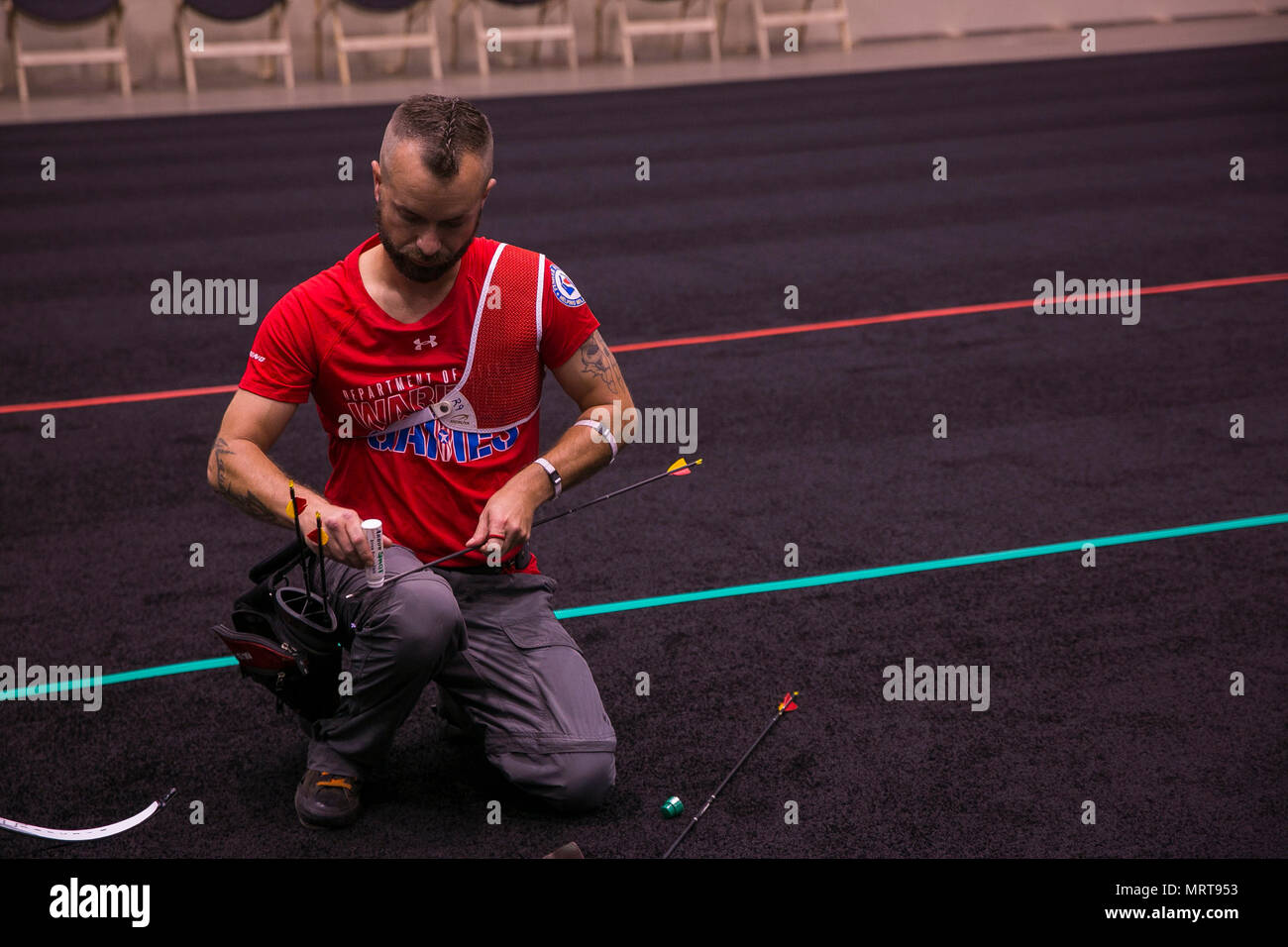 U.S. Marine Corps veteran Matthew Francis waxes his arrow during archery practice at the 2017 DoD Warrior Games at McCormick Place in Chicago, June 29, 2017. Francis, a native of Danville, Va., is a member of 2017 DoD Warrior Games Team Marine Corps. The DoD Warrior Games is an adaptive sports competition for wounded, ill and injured service members and veterans. (U.S. Marine Corps photo by Lance Cpl. Juan Madrigal) - Stock Image