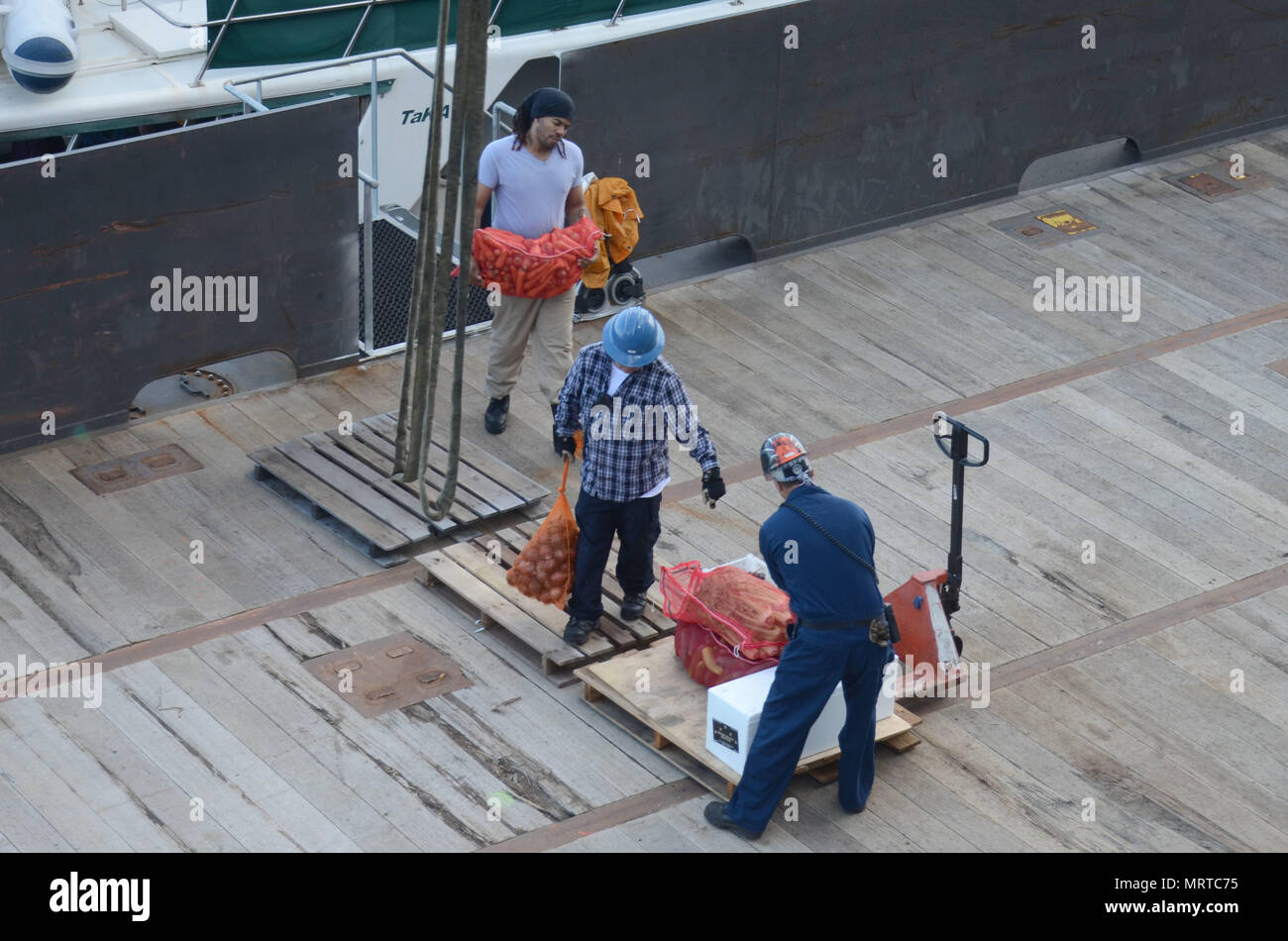 170706-N-WJ640-007 NOUMEA, New Caledonia (July 06, 2017) Civilian Mariners onboard USNS Sacagawea (T-AKE 2), onload stores and supplies off shore Noumea, New Caledonia in support of Koa Moana 17, July 6. Koa Moana 17 is designed to improve theater security, and conduct law enforcement and infantry training in the Pacific region in order to enhance interoperability with partner nations. (U.S. Navy photo by Mass Communication Specialist 3rd Class Madailein Abbott) Stock Photo