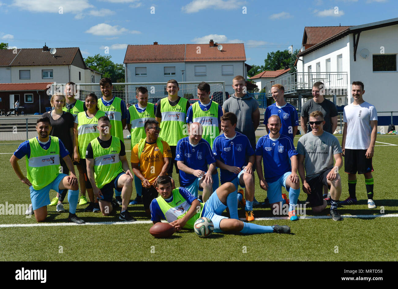 Ramstein Air Base Airmen and Fussballverein Ramstein Fußball Club A-Team pose for a photo during the Grassroots program sports day, at FV Olympia Field in Ramstein Misenbach, Germany, June 24, 2017. More than 25 Airmen and soccer players volunteered for the event to help build relations between service members and the local community. (U.S. Air Force photo by Staff Sgt. Nesha Humes) - Stock Image