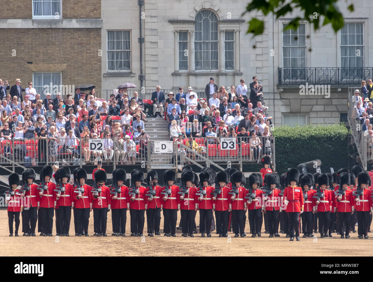 Panorama of Trooping the Colour military ceremony at Horse Guards Parade, London, showing Royal Guards (Queen's Guards) in red and black uniform - Stock Image