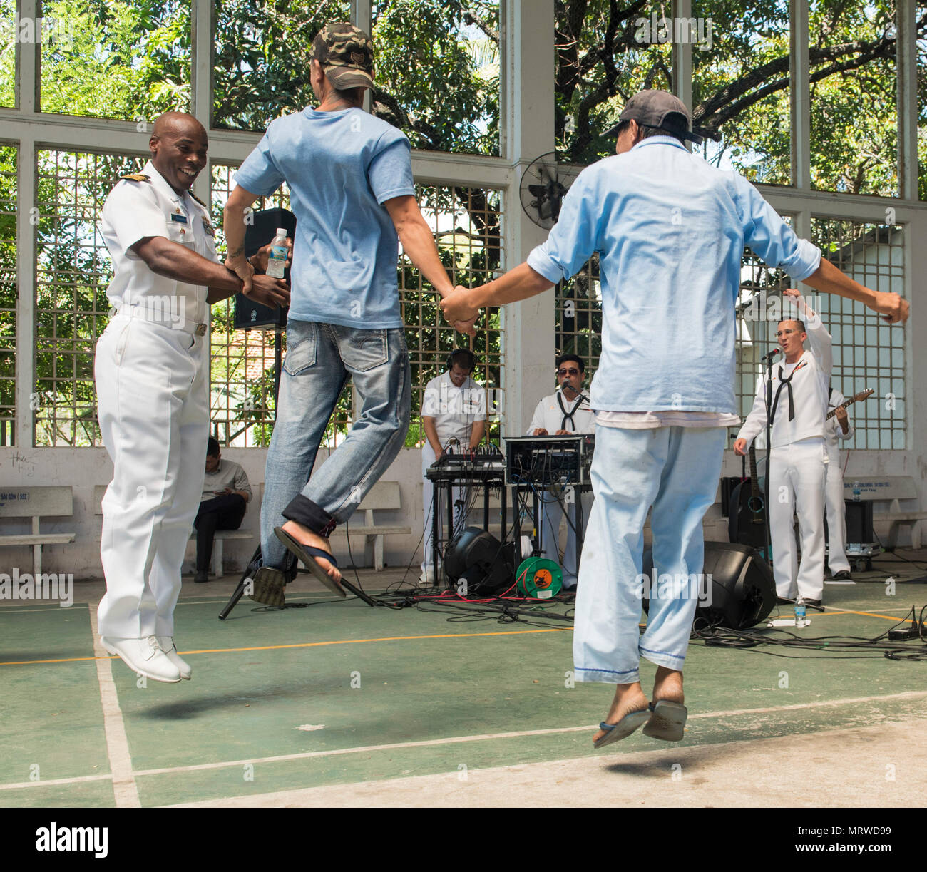 170707-N-OU129-189 KHANH HOA, Vietnam (July 7, 2017) Capt. Lex Walker, commodore, Destroyer Squadron 7, dances with residents and staff of Khanh Hoa Specialty Mental Hospital during a performance by the U.S. 7th Fleet Band, Orient Express as a part of Naval Engagement Activity (NEA) Vietnam 2017 July 7. The engagement provides an opportunity for Sailors from the U.S. and Vietnam People's Navy to interact and share knowledge to enhance mutual capabilities and strengthen solid partnerships with the local community. (U.S. Navy photo by Mass Communication Specialist 2nd Class Joshua Fulton/Release Stock Photo