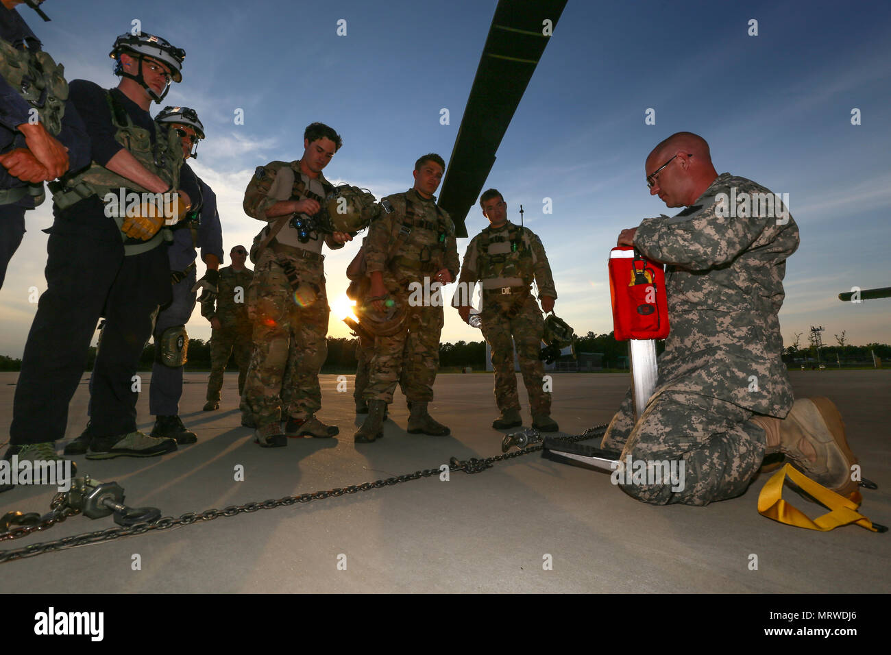 fabd6259bbe6d3 U.S. Army Sgt. Timothy Witts, a Black Hawk crew chief, briefs New Jersey