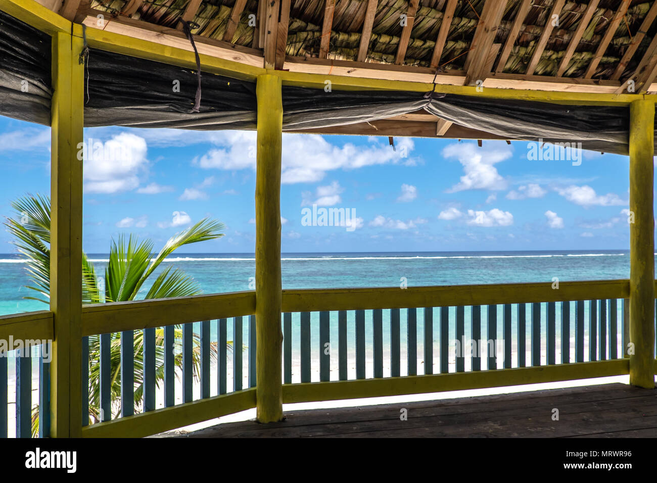 Lalomanu Beach, Upolu Island, Samoa - October 27, 2017: View from inside a traditional waterfront beach fale hut onto the blue Pacific Ocean. - Stock Image