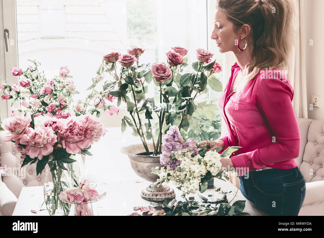 Pretty Modern Florist Women Arranging Great Festive Flowers Bouquet With Urn Vase Roses And Various Flowers At Window Step By Step Holidays And Eve Stock Photo Alamy
