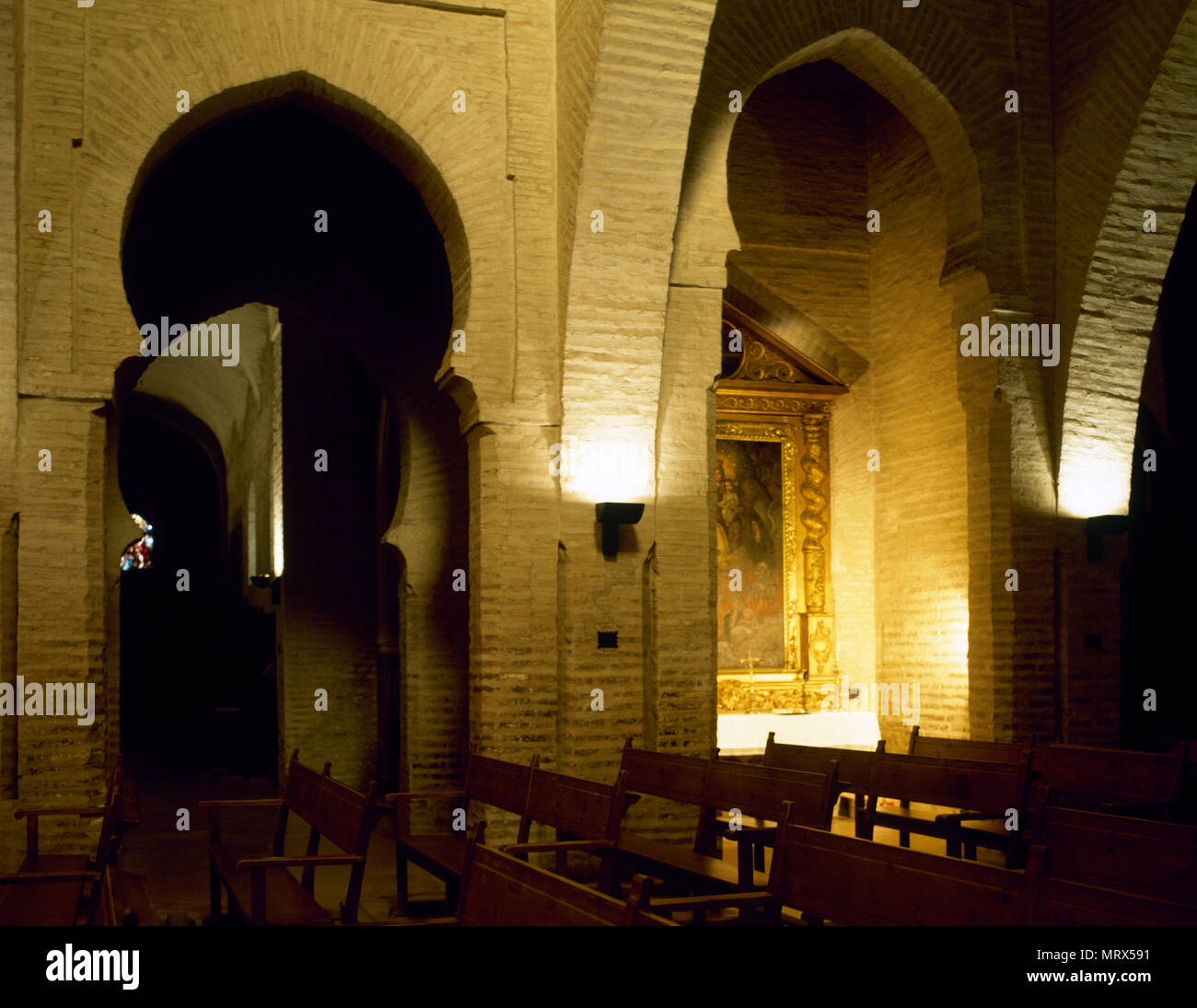 Villalba del Alcor, province of Huelva, Andalusia, Spain. Church of Saint Bartholomew. Almohad style interior of the 'ribat' remains of the 12th century and Mudejar additions 13th-16th century. The church was originally built to defend the area and brings together various styles. - Stock Image