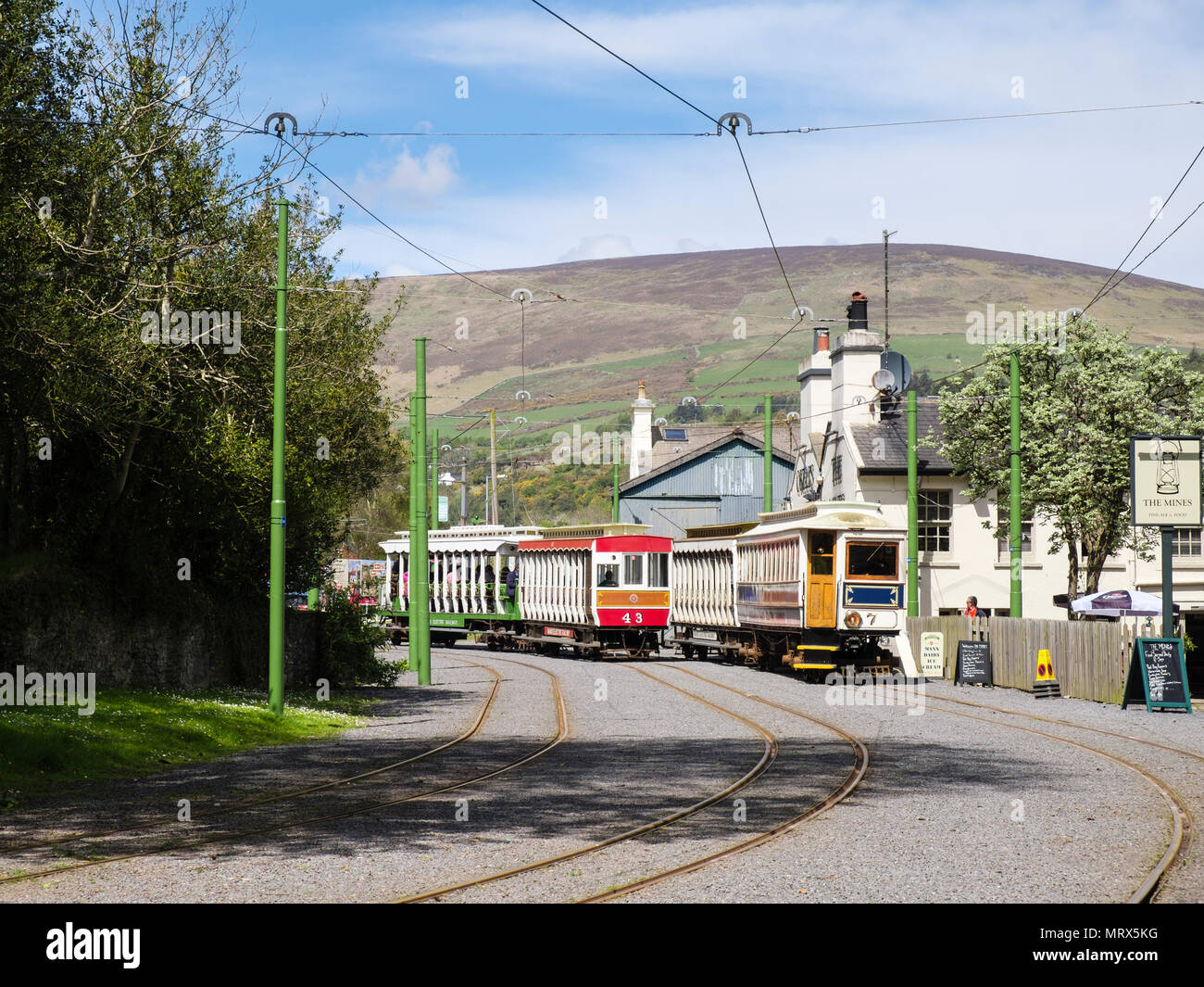 Manx Electric Railway trains passing near station in Laxey, Isle of Man, British Isles Stock Photo