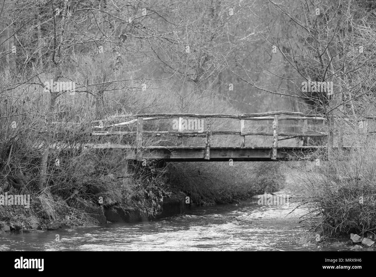 Bridge over a stream - Stock Image