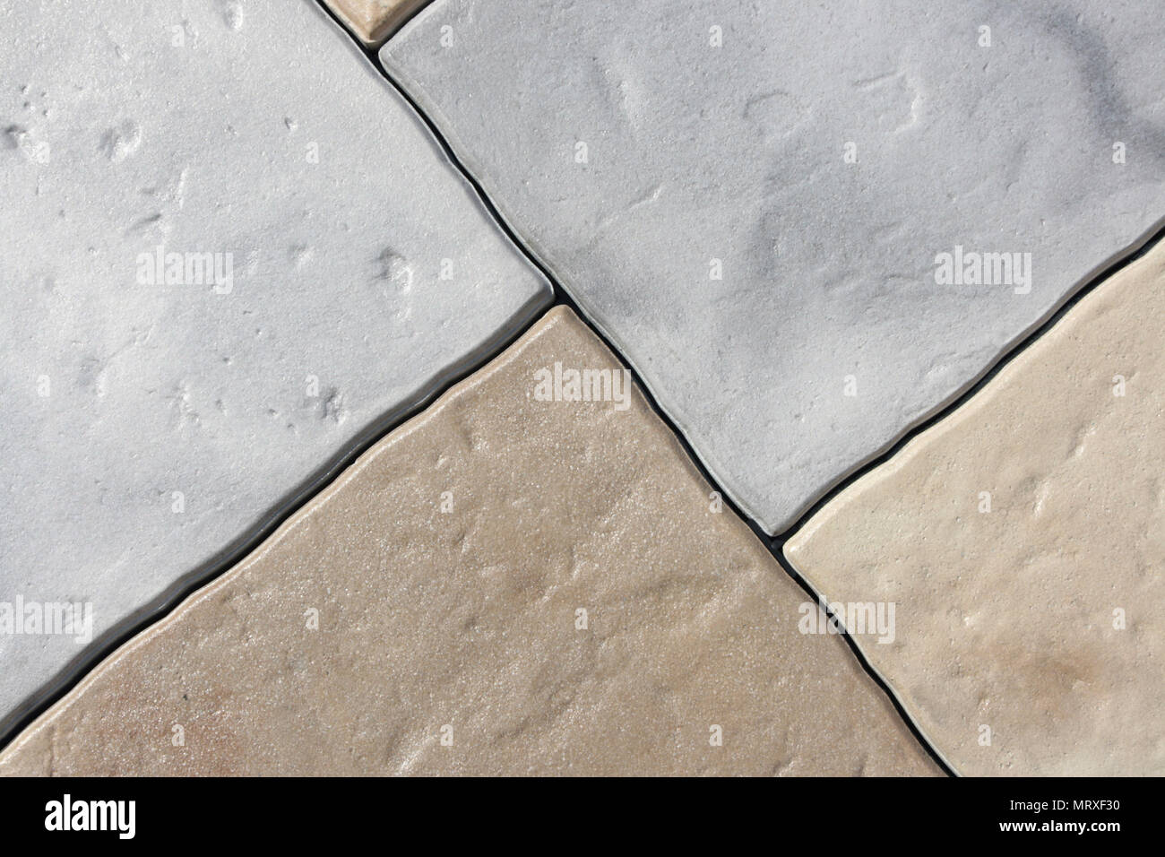 Vintage tiles light gray and light brown with uneven edges stock