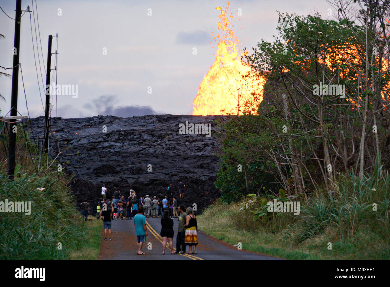 Members of the media view a massive lava wall near fissure 7 at the Leilani Estates residential area caused by the eruption of the Kilauea volcano May 26, 2018 in Pahoa, Hawaii.Stock Photo