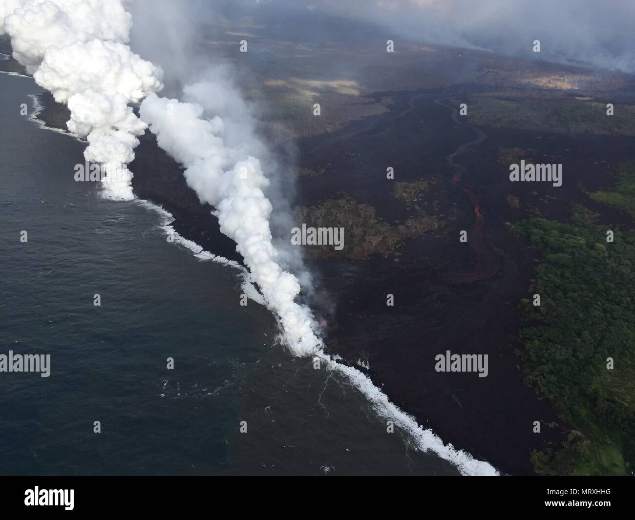 Lava and poisonous sulfur dioxide plumes rise as molten