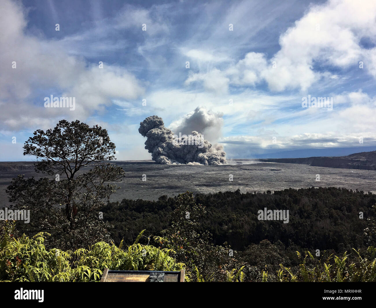 An ash plumes rises from the Halemaumau crater at the summit of the Kilauea volcano May 25, 2018 in Pahoa, Hawaii. Stock Photo