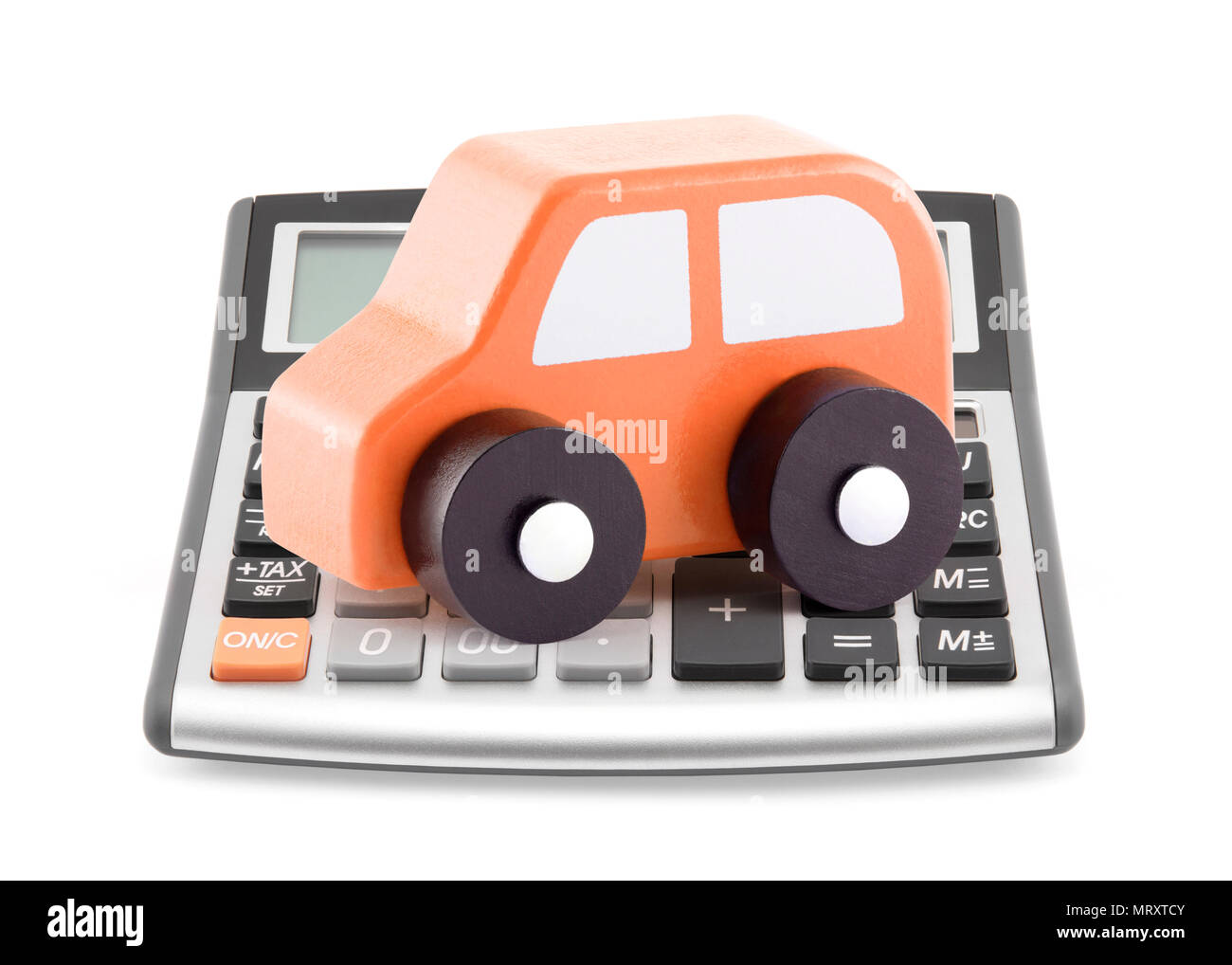 Calculator and orange toy car - Stock Image