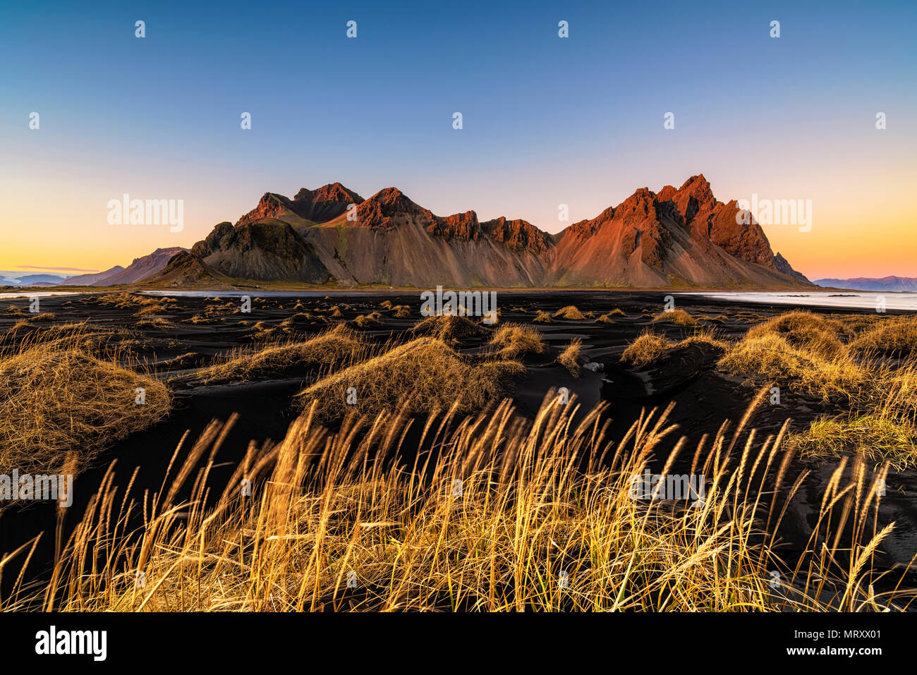 Stokksnes, Hofn, Eastern Iceland, Iceland. Vestrahorn mountain and the black sand dunes at sunset. - Stock Image