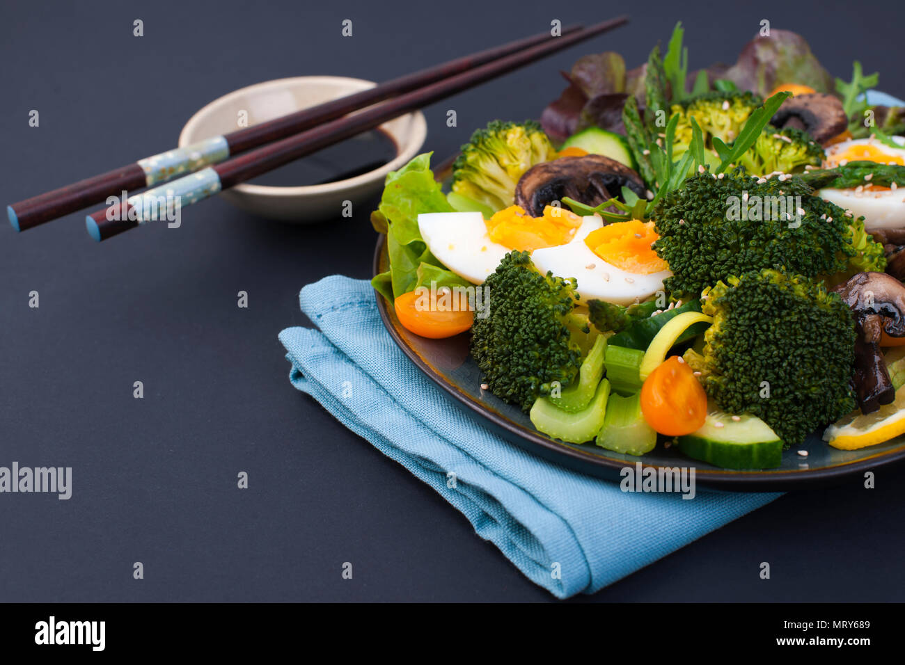 Salad From Vegetables On A Black Background Vegetarian