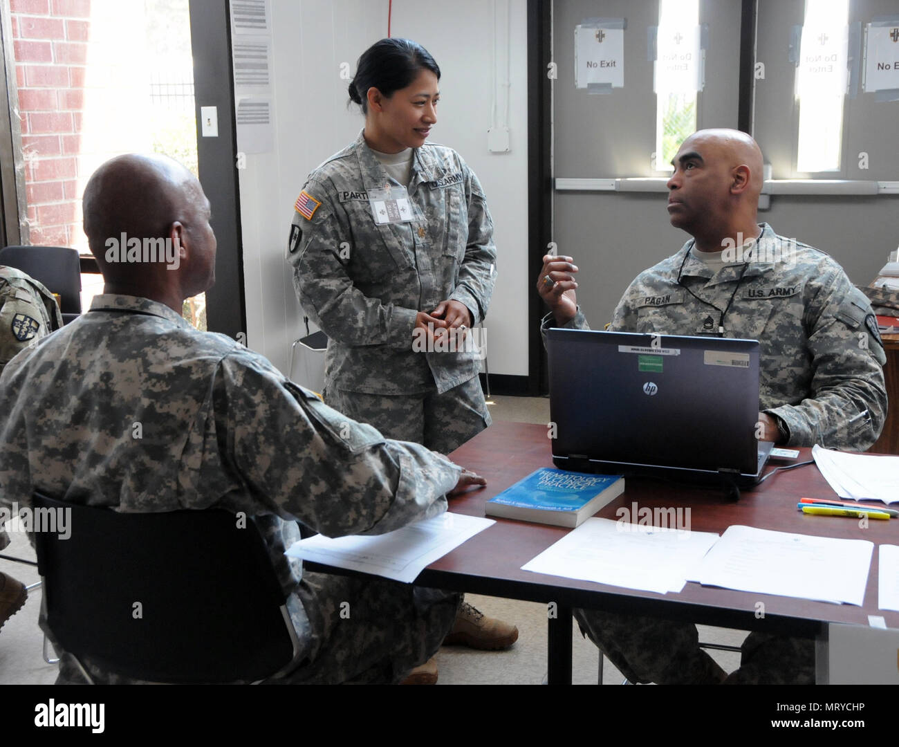Sgt. 1st Class Luis Pagan, a practical nursing specialist (far right) assigned to Army Medical Department Professional Management Command (APMC), and Maj. Ausha Partido, the mobilization officer for Western Medical Area Readiness Support Group (middle), are assisting U.S. Army Reserve Soldiers assigned to the 7452nd Medical Backfill Battalion who have been identified to prepare for a Professional Filler System (PROFIS) mission.   Soldiers mobilized to support this mission will backfill Medical Command's active duty slots at medical centers and clinics across their health care organization.  AP - Stock Image