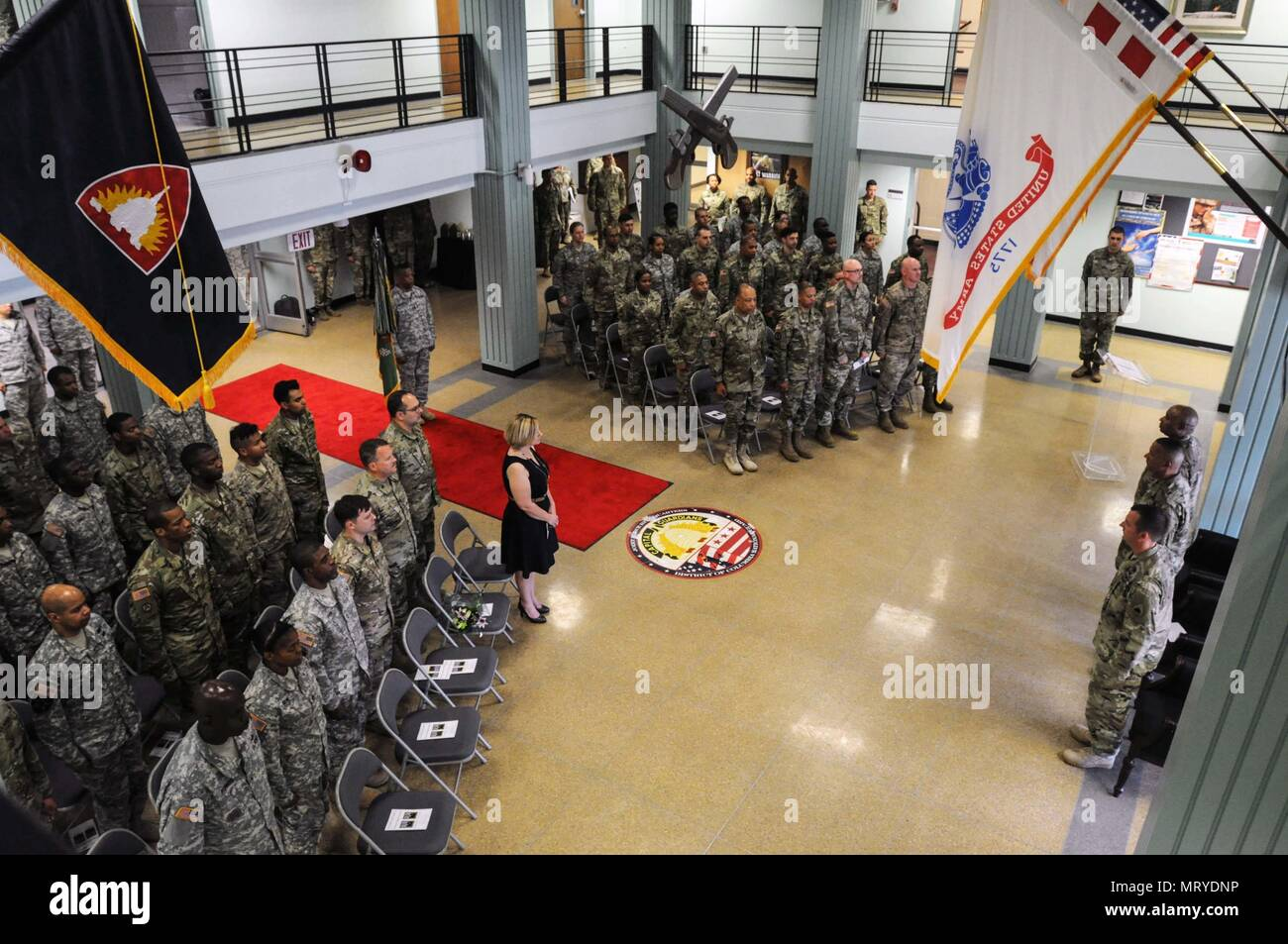Col  Robert F  Weir, commander, 74th Troop Command, pins the