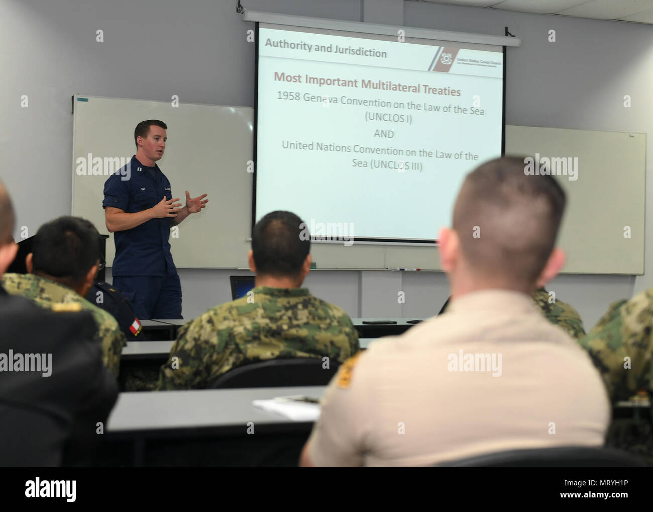 170716-N-PQ607-006  LIMA, Peru (July 16, 2917) - U.S. Coast Guard Lt. Andrew Ray conducts a maritime law enforcement symposium with UNITAS partner nation participants from Mexico, Peru, Honduras and Chile. UNITAS is an annual exercise that focuses on strengthening our existing regional partnerships and encourages establishing new relationships through the exchange of maritime mission-focused knowledge and expertise throughout the exercise. (U.S. Navy photo by Mass Communication Specialist 2nd Class Michael Hendricks/Released) Stock Photo