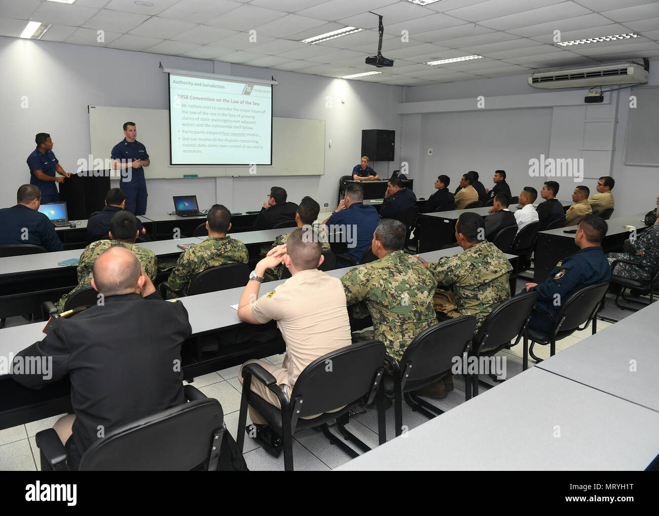 170716-N-PQ607-009  LIMA, Peru (July 16, 2917) - U.S. Coast Guard Lt. Andrew Ray conducts a maritime law enforcement symposium with UNITAS partner nation participants from Mexico, Peru, Honduras and Chile. UNITAS is an annual exercise that focuses on strengthening our existing regional partnerships and encourages establishing new relationships through the exchange of maritime mission-focused knowledge and expertise throughout the exercise. (U.S. Navy photo by Mass Communication Specialist 2nd Class Michael Hendricks/Released) - Stock Image