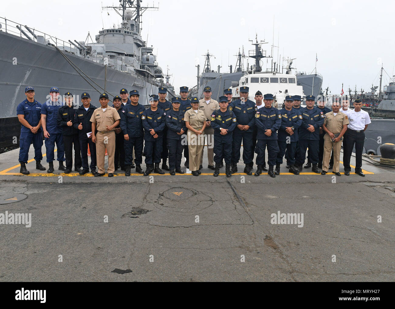 170716-N-PQ607-068  LIMA, Peru (July 16, 2917) - U.S. Coast Guard Lt. Andrew Ray conducts a maritime law enforcement symposium with UNITAS partner nation participants from Mexico, Peru, Honduras and Chile. UNITAS is an annual exercise that focuses on strengthening our existing regional partnerships and encourages establishing new relationships through the exchange of maritime mission-focused knowledge and expertiese throughout the exercise. (U.S. Navy photo by Mass Communication Specialist 2nd Class Michael Hendricks/Released) - Stock Image