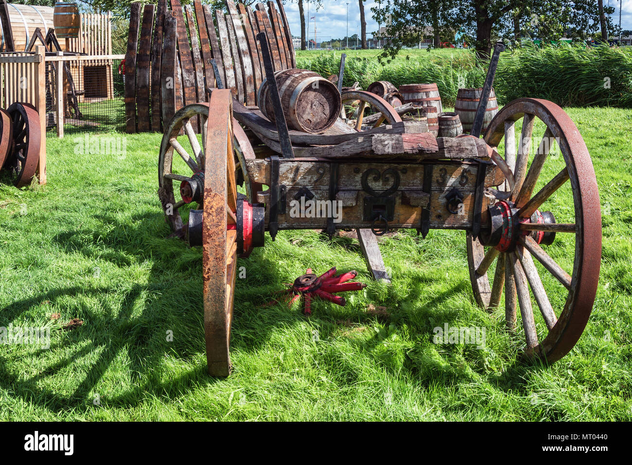 An old barrel car parked in the grass. - Stock Image