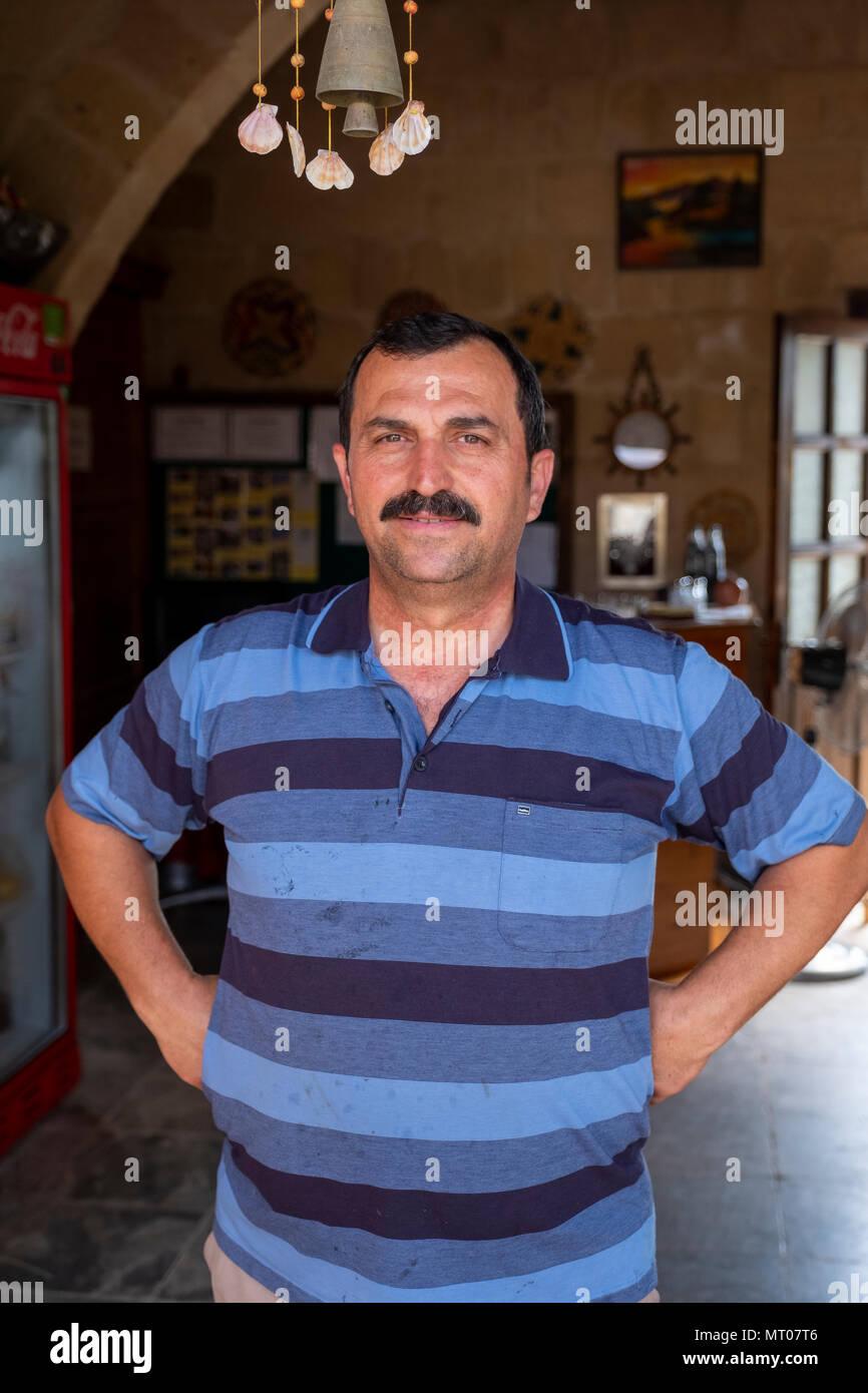 Portrait of Ali Ozbayrak guest house proprietor at the Revakli Ev guest house in Dipkapaz (Rizokarpazo) Northern Cyprus - Stock Image