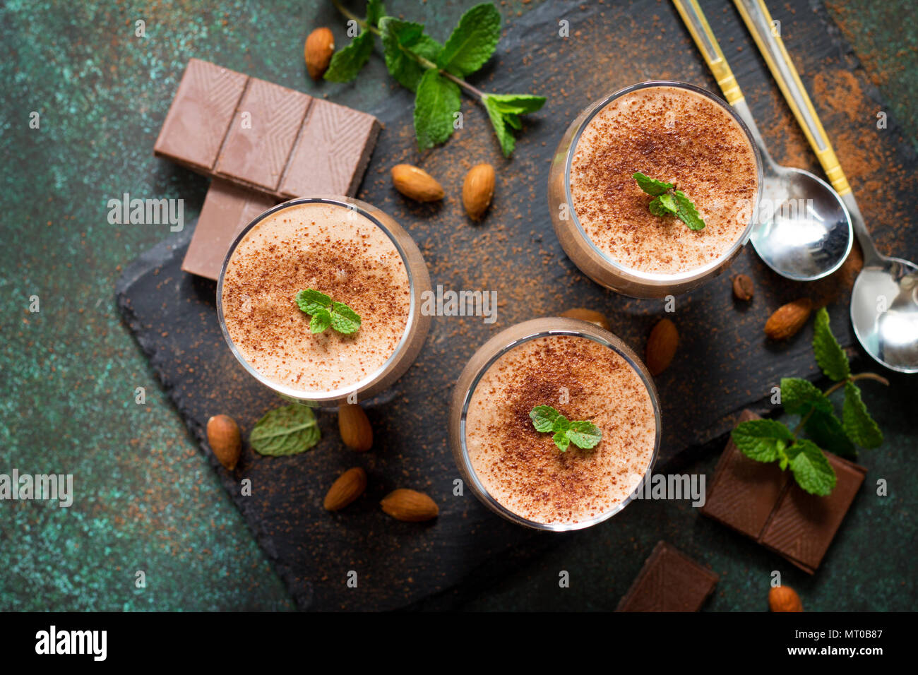 Homemade coffee-chocolate mousse on a stone or slate background. - Stock Image