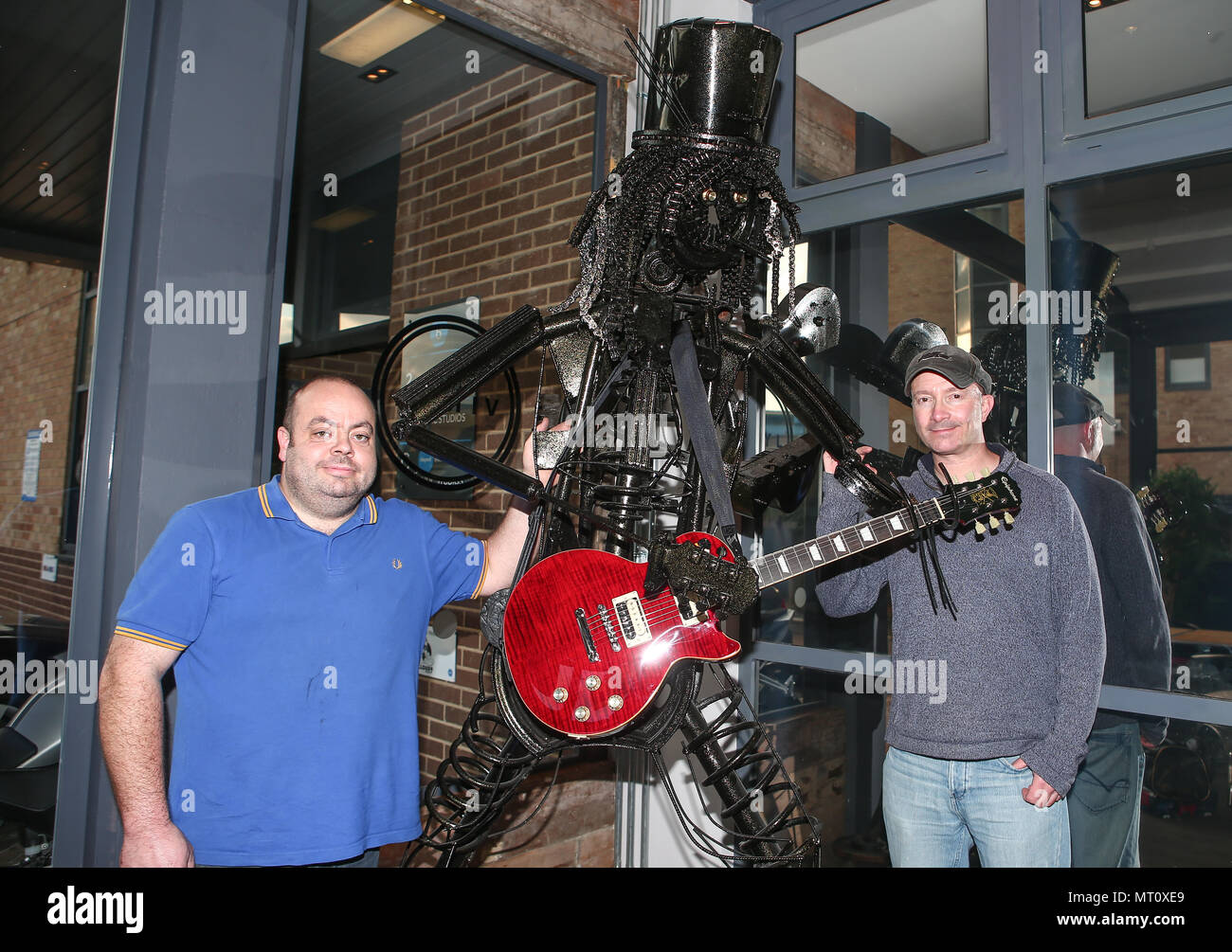 PICTURE SHOWS: Welder/finisher Darren Kenny and artist Simon Weitzman.  .....   A unique sculpture of rock musician Slash is going under the hammer.  The larger-than-life, 7.5 feet tall work has been painstakingly fashioned from recycled car, bike and instrument parts.  Officially signed by Slash in two places, it is the work of artist Simon Weitzman and welder/finisher Darren Kenny, of Heavy Metal Sculptures (https://www.heavymetalsculptures.com/)  It was made to benefit IFAW, the International Fund for Animal Welfare, of which Slash acts as an ambassador, and comes fitted with a Slash signat Stock Photo