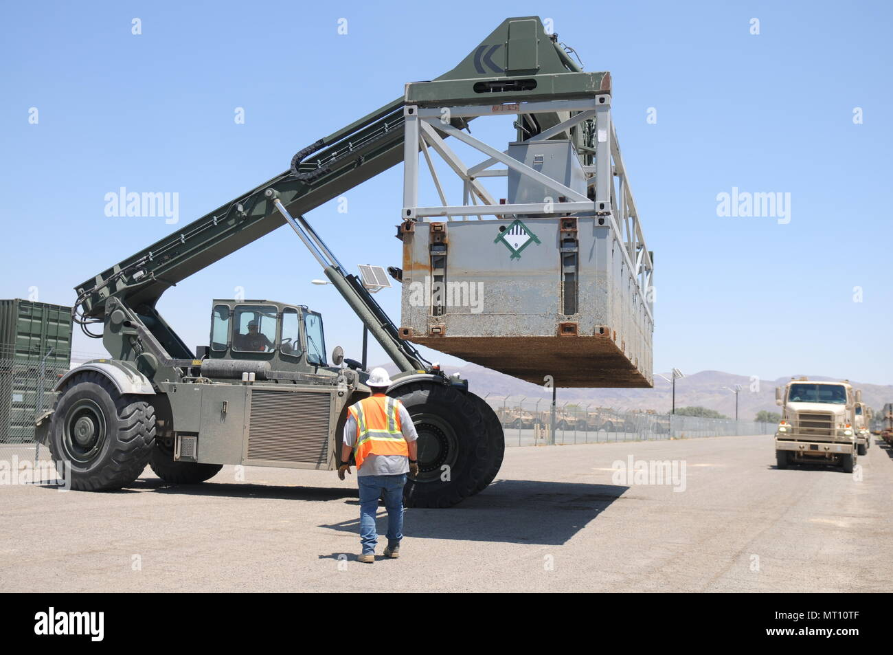 A portion of a Modular Causeway System (MCS) is moved into position so it can be loaded onto a 250th TC M915 truck for transport to the Port of San Diego as a part of Exercise Big LOTS West 17. - Stock Image