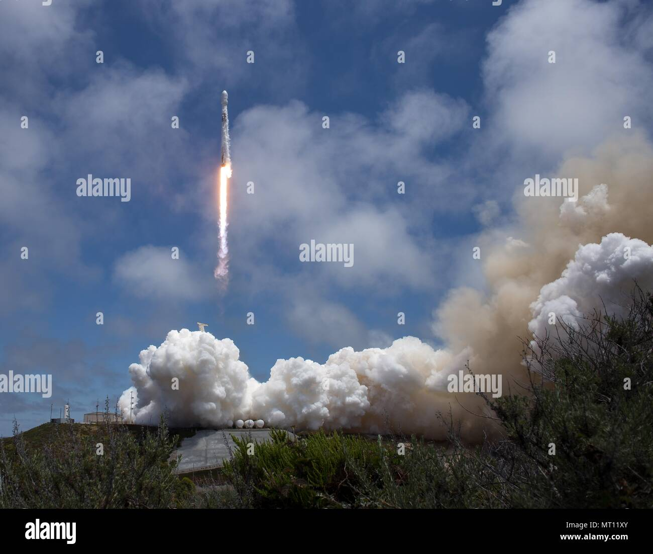 The SpaceX Falcon 9 rocket carrying the NASA German Research Centre for Geosciences GRACE Follow-On spacecraft launches from Space Launch Complex 4E at Vandenberg Air Force Base May 22, 2018 in Vandenberg, California. The GRACE-FO mission is sharing its ride to orbit with five Iridium NEXT communications satellites as part of a commercial ride share agreement. Stock Photo