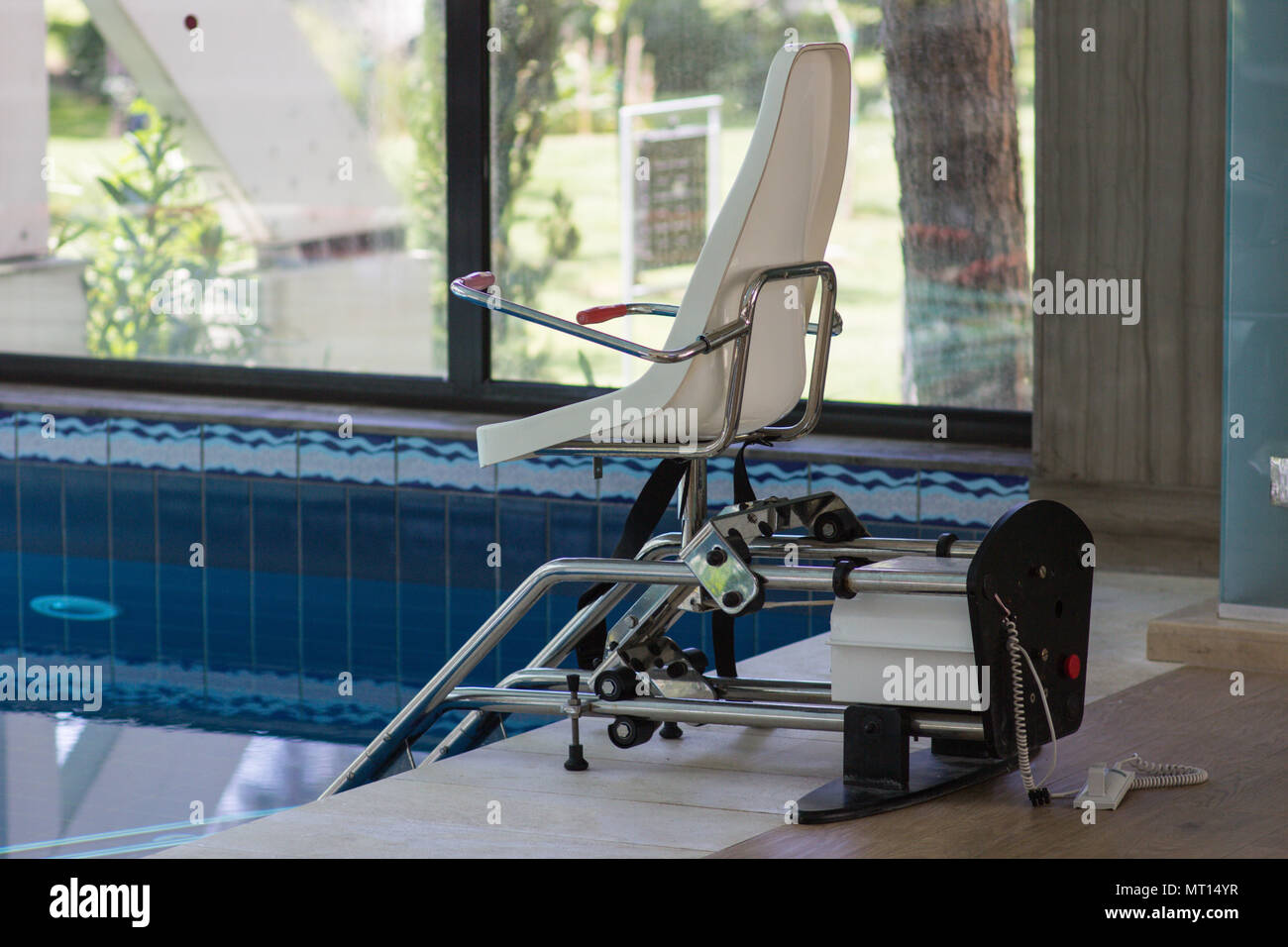 chair lift device for disabled people in close swimming pool stock