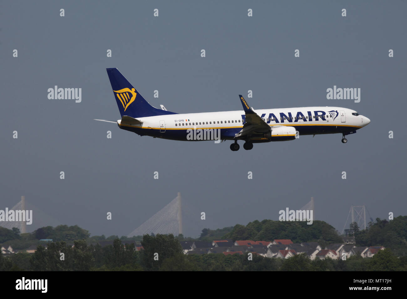 Ryanair Boeing 737-8AS plane EI-DPB flies into Edinburgh airport with the Queensferry crossing bridge in the background Stock Photo