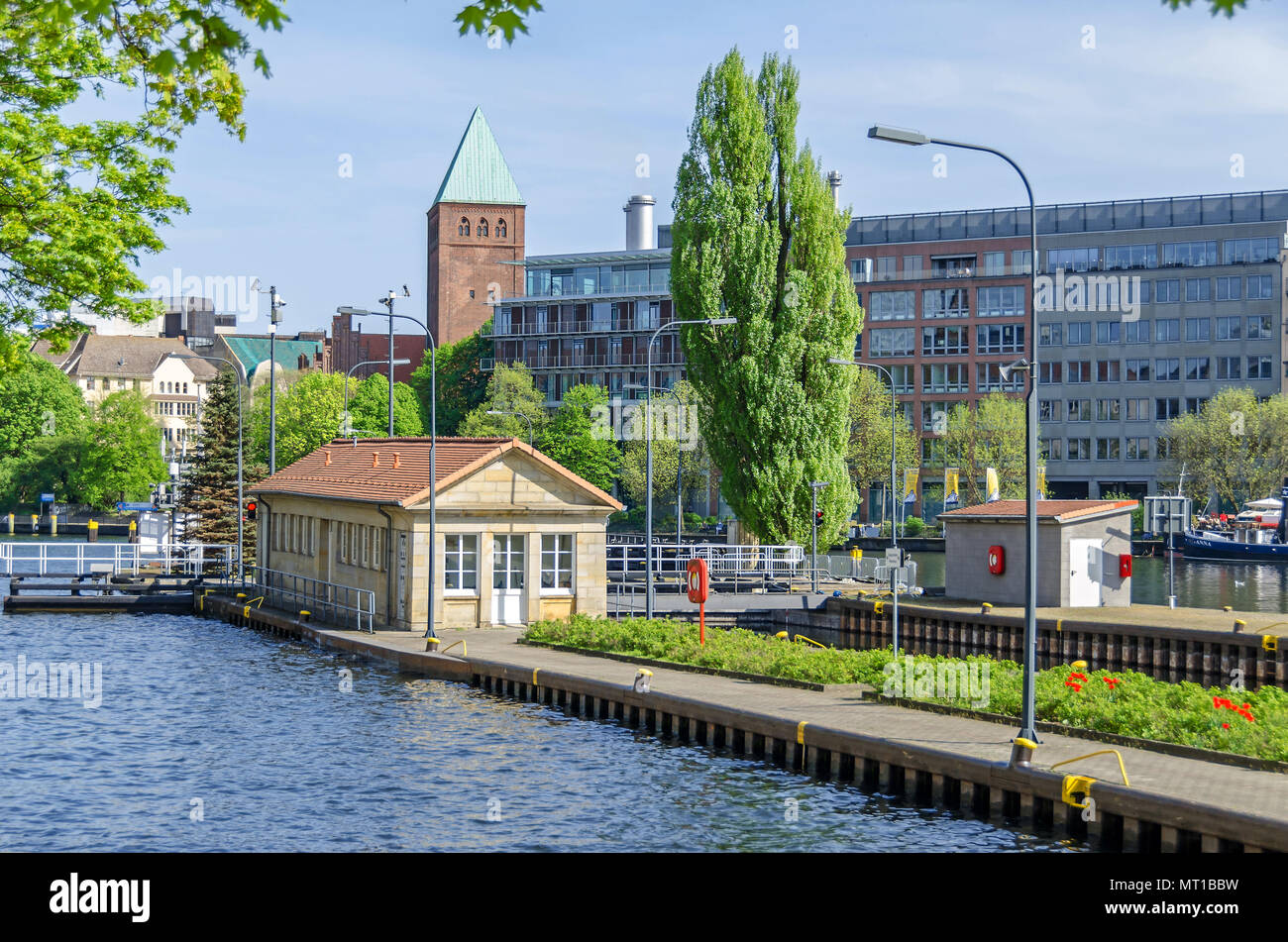Multi-chamber Muehlendamm locks in the central Mitte district of Berlin making the river Spree navigable, and the tower of the Marcher Museum Stock Photo